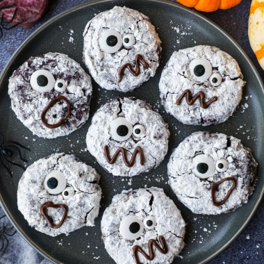 These spooky halloween monster cookies are the perfect treat to make this year! They're loaded with chocolate chips, coated in powdered sugar and have a rich fudgy center!