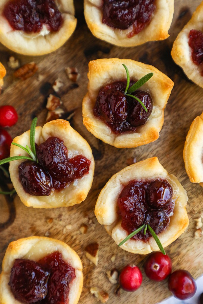 These mini baked brie bites are a holiday dish that everyone can enjoy! They're sweet, creamy and have the perfect flakey crust!