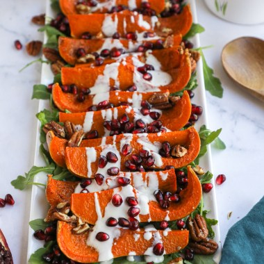 We just can't get enough of this simple side dish for the holidays! The honeynut squash takes no time at all to roast in the oven and is then topped with an easy homemade yogurt sauce!