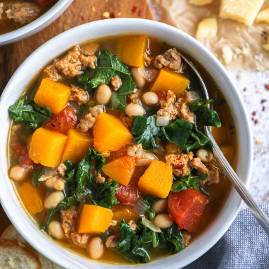 Warm and hearty Italian sausage, butternut squash and kale soup! It's the best way to stay cozy this fall and winter!