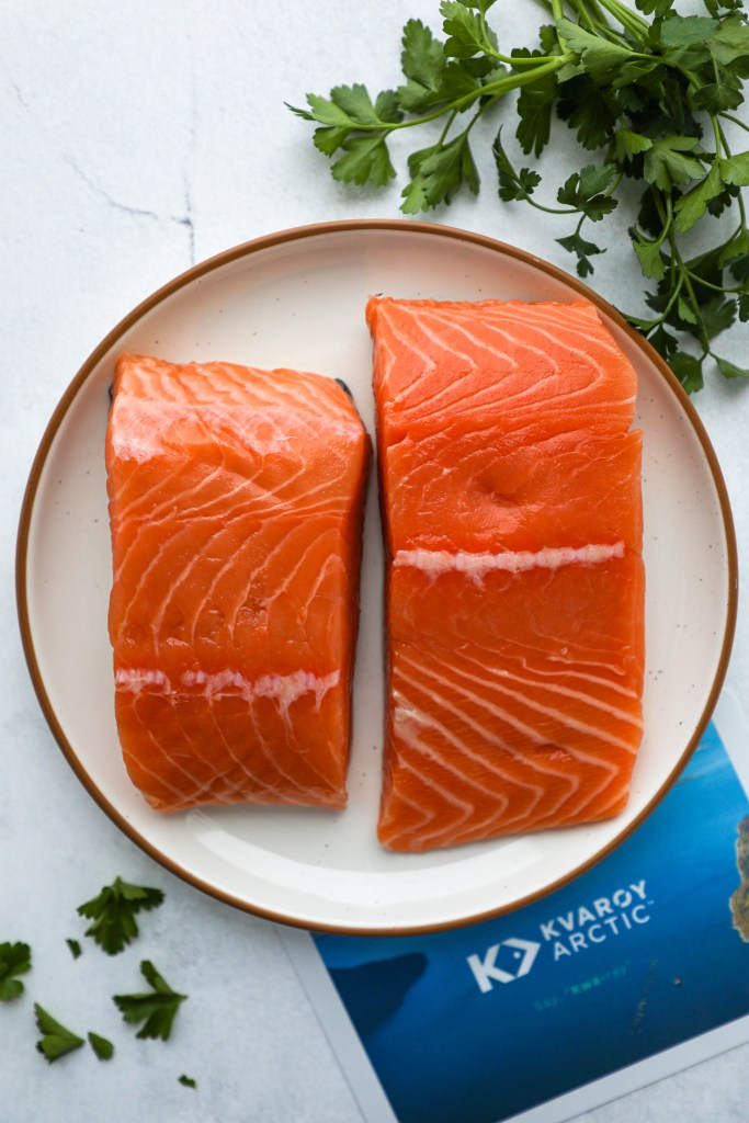 Fresh farm-raised salmon makes such a great easy dinner option! Just sear it in a pan and drizzle it with my favorite lemon dijon sauce and you've got one delicious meal!