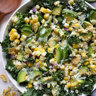 Close up of Mexican street corn kale salad served in a white bowl