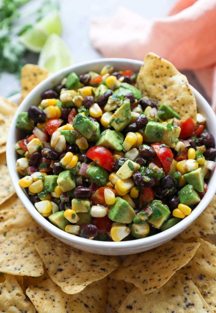 Salsa made with black beans, tomatoes, fresh corn, red onion, cilantro, avocado and lime