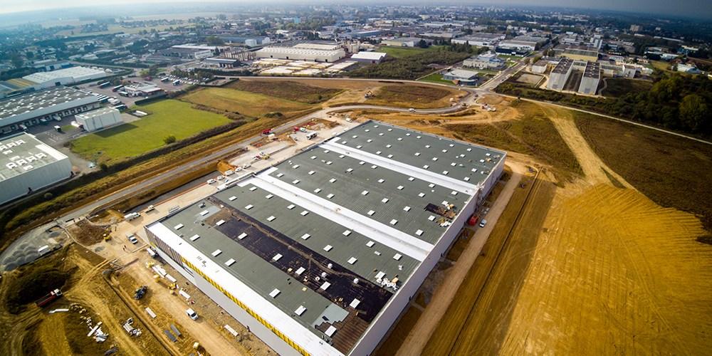Vue aérienne de l'extension de Saônéor avec le nouveau bâtiment d'Alainé en premier plan.