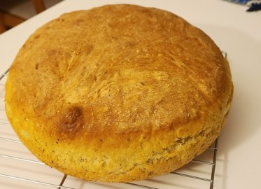 son's peasant bread out of the oven