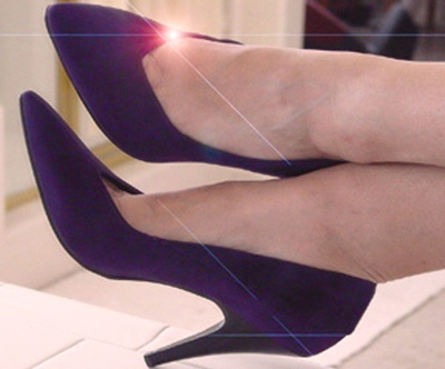 ankles crossed in real deep purple velvet high heels