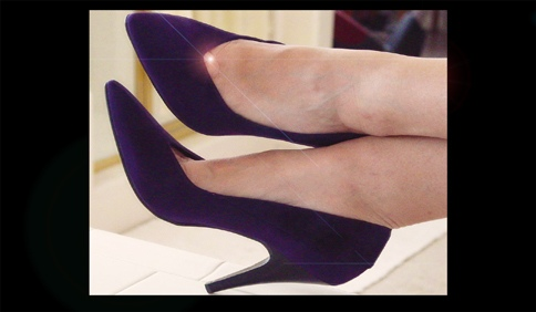 KK's purple suede stilettos mean business
