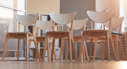 empty wooden chairs in conference room