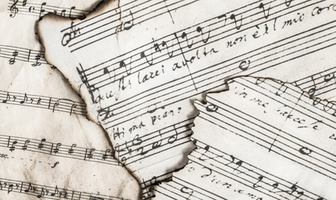 music sheets with handwritten lyrics