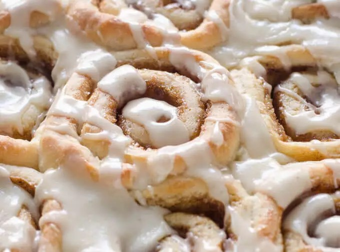 Close-up of frosted eggnog cinnamon rolls