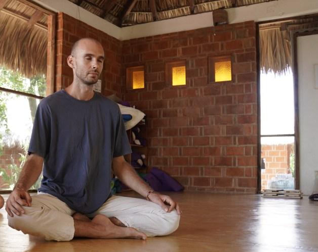 Adam in seated meditation posture