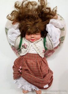 This charming doll carried a big heart on her back.