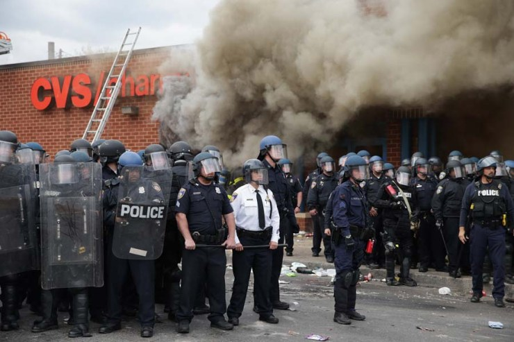 BALTIMORE, MD - APRIL 27: Baltimore Police form a parimeter around a CVS pharmacy that was looted and burned near the corner of Pennsylvania and North avenues during violent protests following the funeral of Freddie Gray April 27, 2015 in Baltimore, Maryland. Gray, 25, who was arrested for possessing a switch blade knife April 12 outside the Gilmor Homes housing project on Baltimore's west side. According to his attorney, Gray died a week later in the hospital from a severe spinal cord injury he received while in police custody.   Chip Somodevilla/Getty Images/AFP == FOR NEWSPAPERS, INTERNET, TELCOS & TELEVISION USE ONLY ==