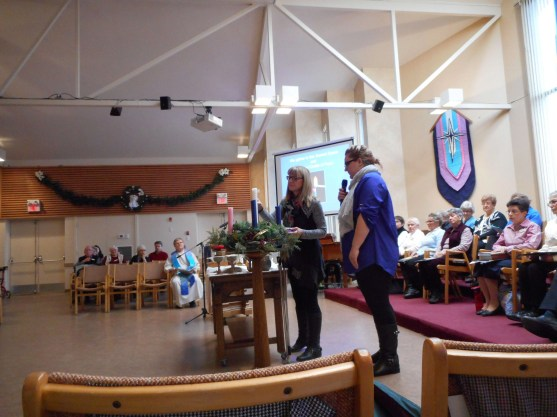Chris and Alix Dolson lights the Advent Candle.