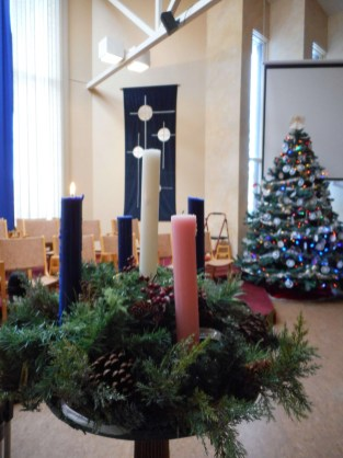 The Advent Candle Wreath with the 3 Crosses banner and the Advent Tree in the background.