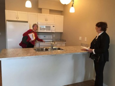 Cheryl and Phyllis admire one of the kitchens.