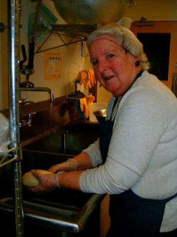Margaret peeling potatoes.
