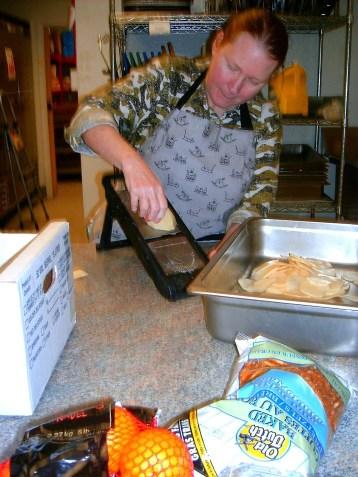 Tammy slicing potatoes.