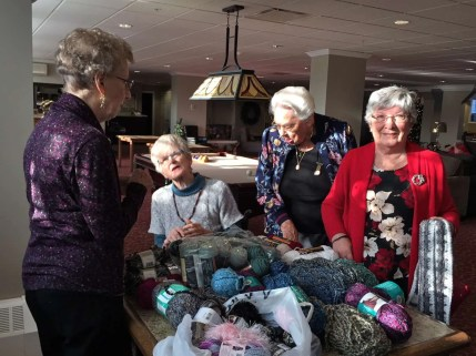 Doreen, Leslie, Muriel, and Corinne sorting through the donated yarns.
