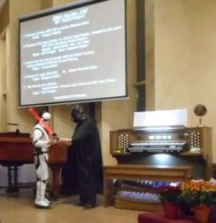 A storm trooper and Darth Vader get ready for the Imperial March