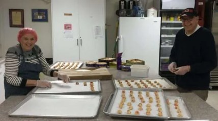 Cathie and Chuck are prepping the Black Forest cookies for the ovens.