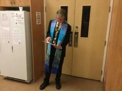 Rev.Bruce taking a moment to prepare