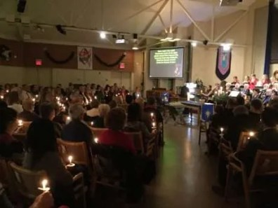Singing Silent Night, Holy Night by candlelight