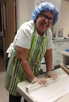 """Becky rolls dough into """"logs""""."""