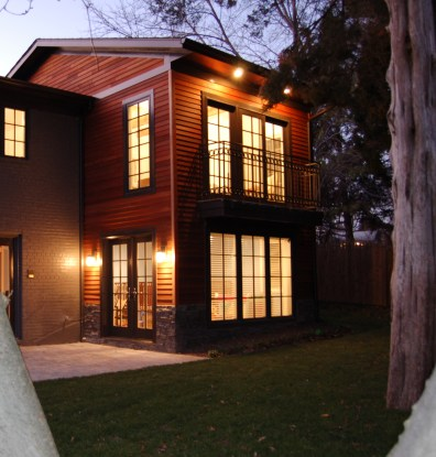 Cedar siding, brick and stone cladding