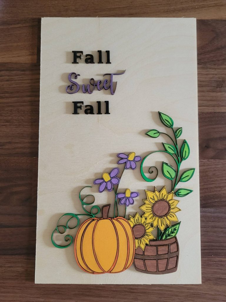 Read more about the article Cute Fall Sign With Pumpkins And Sunflowers