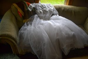 "<img=""Wedding Dress on couch"">"