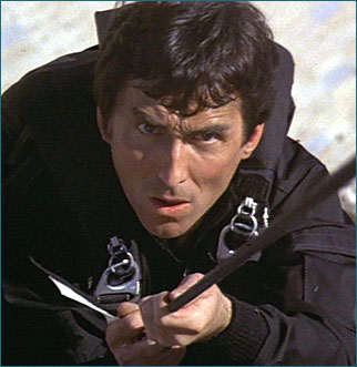 "Accompanied 002 and 007 to Gibraltar in The Living Daylights film; murdered by an individual pretending to be a KGB agent who left a tag on the body that read ""Death to Spies"" in Russian."