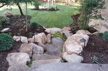 Stone stairs through garden to grass