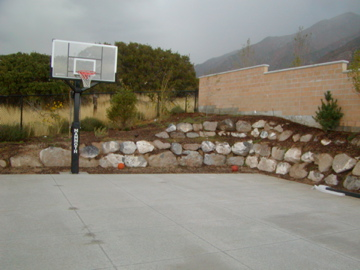 Basketball court with retaining wall