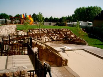 Deck, pool, waterslide, patio, retaining wall, grass