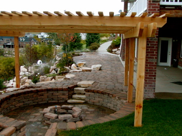 Sunken seat wall firepit with pergola