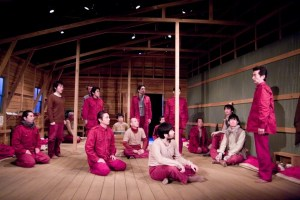 "A scene from ""Kaura no Hancho Kaigi"" with Japanese POWs wearing the crimson uniforms they wore at the Cowra Prison Camp."