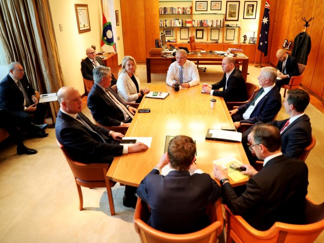 Scott Morrison on Thursday with his leadership team, clockwise from right, Josh Frydenberg, Michael McCormack, Simon Birmingham, Greg Hunt, Christian Porter, Peter Dutton, Mathias Cormann and Bridget McKenzie, and in the outer circle, from left, Yaron Finkelstein, John Kunkel and Julian Leembruggen. Picture: Adam Taylor/PMO