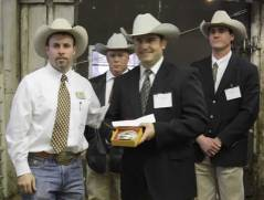 Bob McBride presents the 2009 Livestock Champion buckle to Charly Cummings