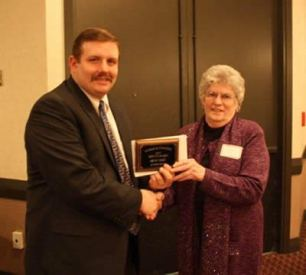 Andy Conser presents the 2010 Service Award to Peggy Giles, Ag Press.