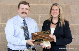 President Andy Conser presents championship plaque and buckle to Megan McCurdy
