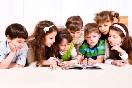 Kids reaching books