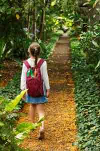 Student walking in botanical garden