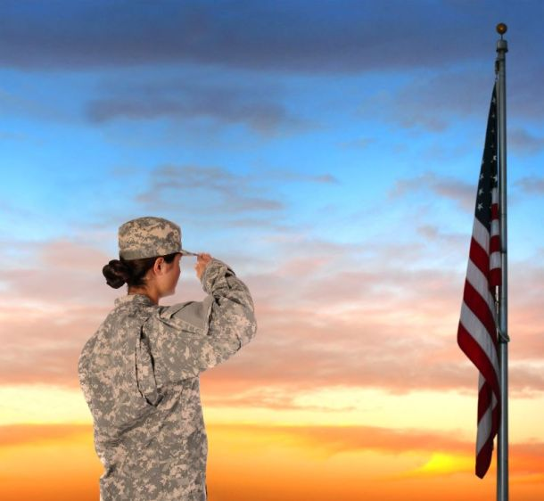 Kansas city Veterans Day Events and Deal - female solider saluting American flag
