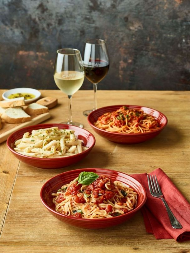 Kansas City restaurant deals - plates of pasta on a table with wine glasses