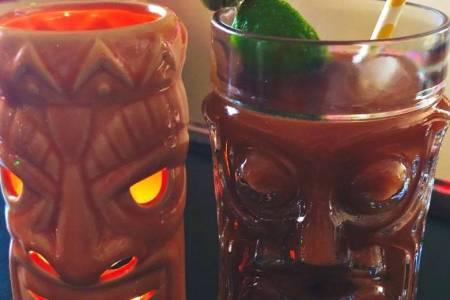 Virtual Happy Hour Tips - two tiki drinks on a bar