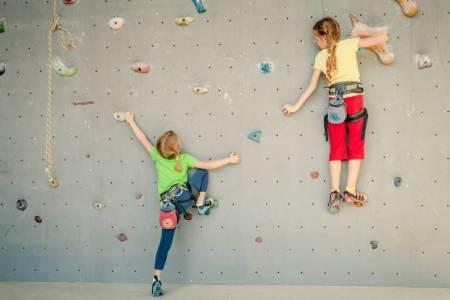 Rock climbing discounts - two girls climbing