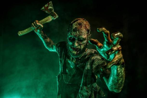 Halloween movies in Kansas City - zombie with ax