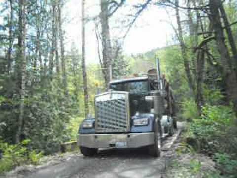 Kenworth log truck with all Super Single Tires on truck and trailer.