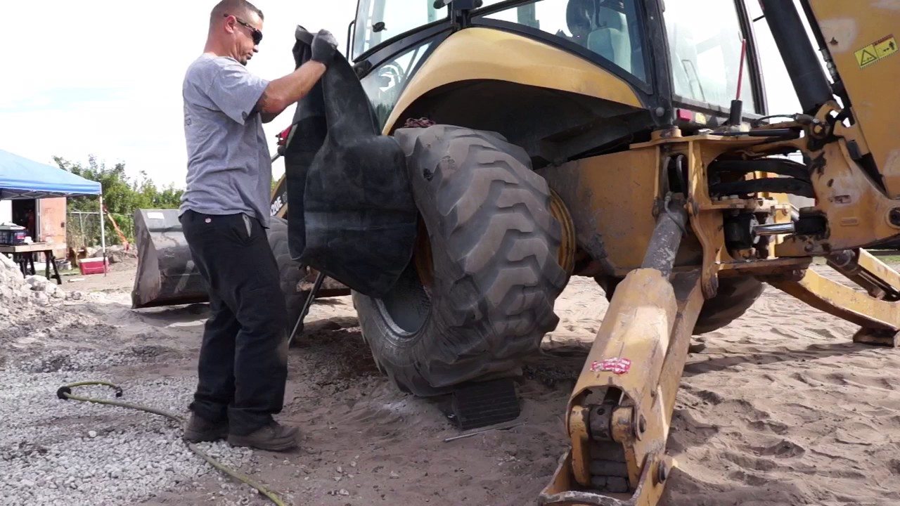 Changing a tire on a backhoe 19.5L-24